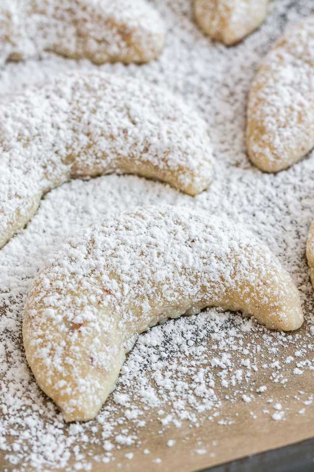 Vanillekipferl are made with ground nuts and dusted with vanilla sugar! These cookies are tender and melt in you mouth. A great recipe for cookie exchanges and Christmas parties!