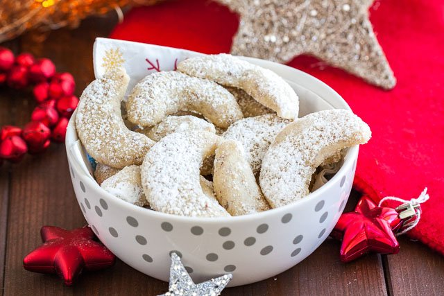 German Vanilla Crescent Cookies are traditional German Christmas Cookies made with ground nuts and dusted with vanilla sugar! They are tender, nutty and melt in your mouth. A perfect cookie to make ahead that's always a hit.