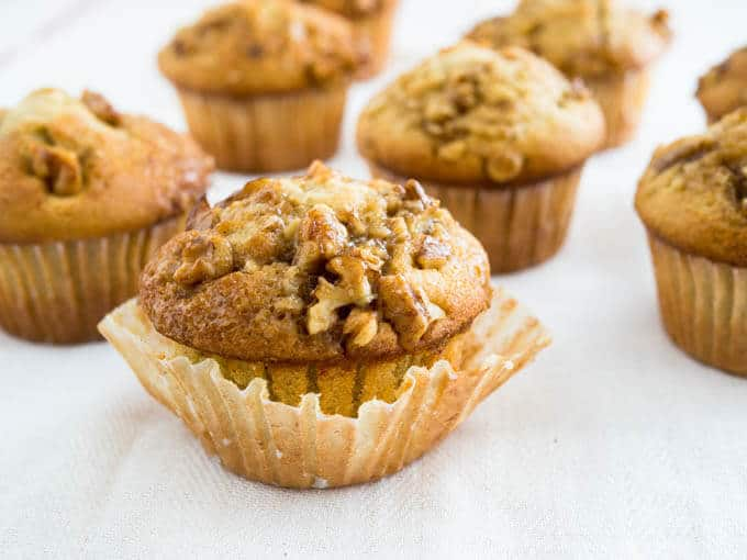 Banana Nut Maple Muffins are on a whole new level! The creamed butter together with the bananas creates a wonderful texture and the caramelized walnuts on top make them a family favorite!