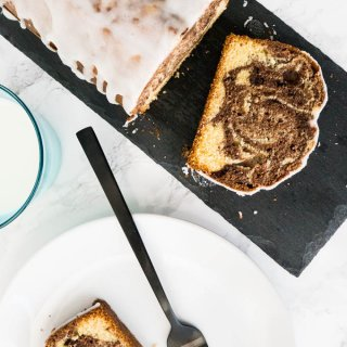 Marbled Orange Pound Cake is made from two different orange infused batters! This delicious cake has a lemon-flavored icing on top and tastes great with a cup of coffee.