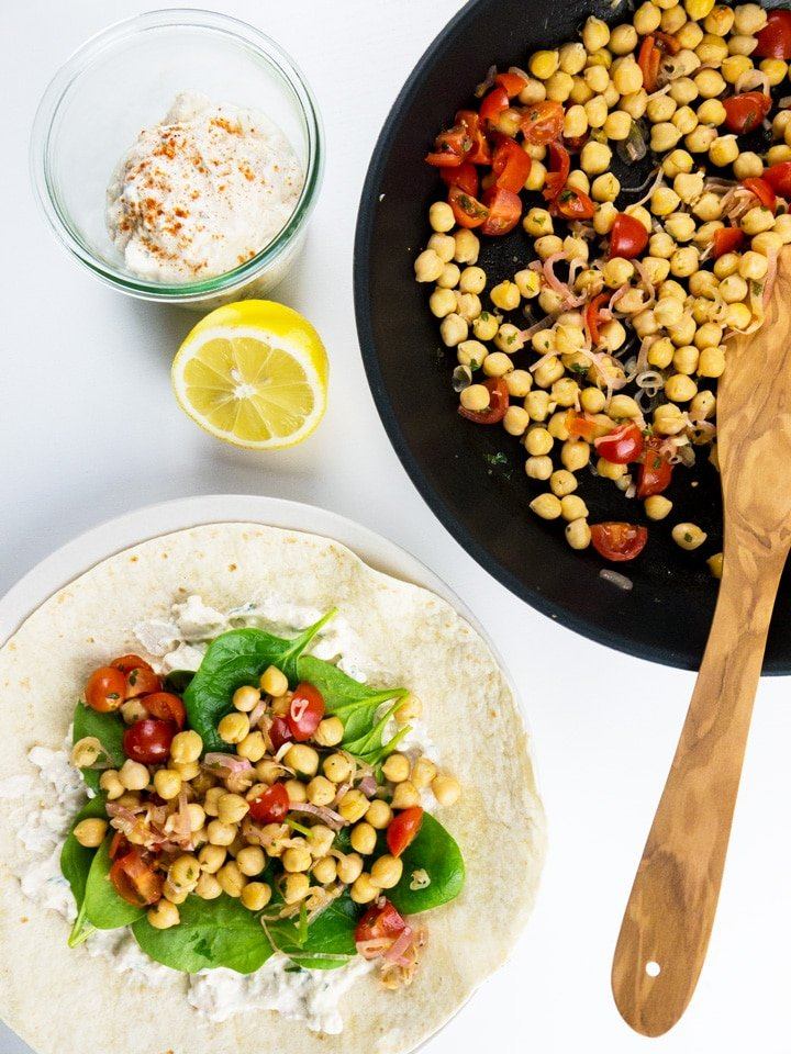 Spinach Wrap with Feta and Chickpeas makes the perfect midweek meal. The wraps are filled with feta spread, healthy chickpeas, and spinach. A great vegetarian dish which is ready in 15 minutes!