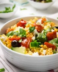 20-minute Greek Couscous Salad makes a great quick weeknight dinner but it's also perfect for parties! This easy recipe is sure to be a crowd-pleaser.