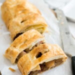 This Puff Pastry Walnut Apple Strudel is made with a Walnut Raisin Apple filling and doesn't get a soggy bottom because of my secret ingredient!