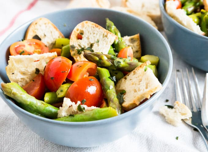 Asparagus Panzanella is made with sweet cherry tomatoes, crispy homemade ciabatta bread chips, and green asparagus! A perfect salad recipe for spring.
