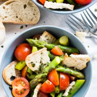 This warm Asparagus Garlic Bread Salad is made with sweet cherry tomatoes, crispy homemade ciabatta bread, and green asparagus! A perfect recipe for spring.