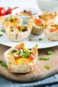 These cheesy Mexican Toast Cups are made in a muffin tin with sandwich bread! Filled with black beans, homemade salsa, cheese and eggs. Perfect for brunch or as a party snack!