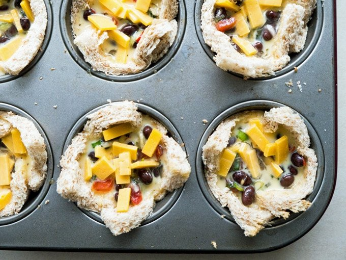 Cheesy Mexican Toast Cups w/ black beans, salsa and egg