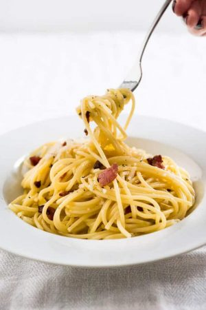 This 15-minute Spaghetti alla Carbonara is the perfect weeknight dinner! It's so fast to make and tastes so rich and creamy - but without using cream.