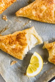 Lemon Puff Pastry Pockets are a perfect summer treat! Crispy caramelized puff pastry with a lemon & ricotta cheesecake filling.