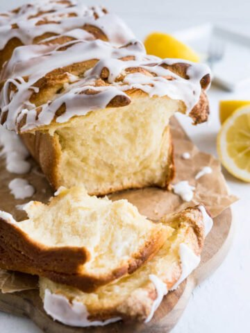 Lemon Pull Apart Coffee Cake - A beautiful light and fluffy sweet bread, filled with lemon butter and topped with a tangy lemon glaze!