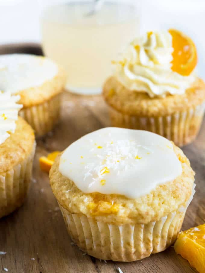 These Coconut Orange Creamsicle Cupcakes are a tropical taste explosion! An orange-infused coconut vanilla cupcake topped w/ orange buttercream or glaze.