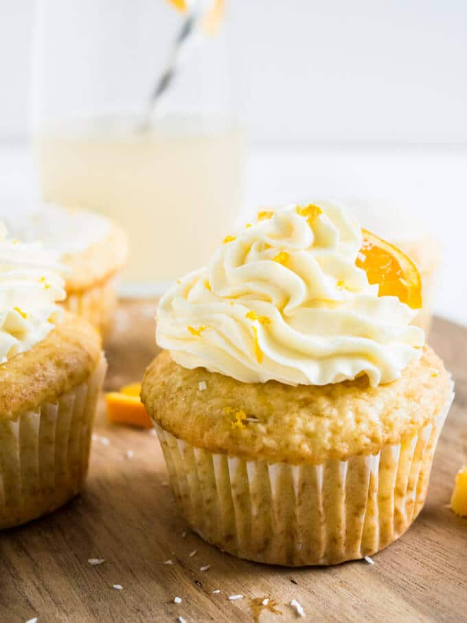 ... infused coconut vanilla cupcake topped w/ orange buttercream or glaze