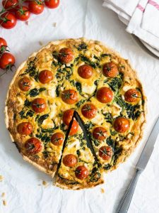 Spinach Tomato Quiche with Pine Nuts and Feta - a quiche packed with great flavors and perfect for every time of the day! I love to make it for dinner and have the leftovers for breakfast.