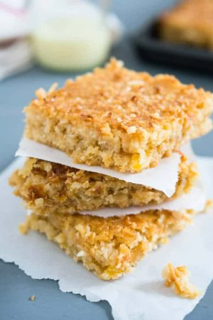 Tropical Coconut Squares taste like candy bars! Three delicious layers topped with sweetened condensed milk make this dessert a naughty little treat.