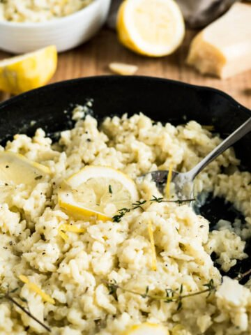 Creamy Lemon Risotto is a perfect summer dish made with parmesan, rosemary, and fresh lemons. Comfort food for sunny days or whenever you need a little bit sunshine in your life!