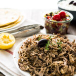 The best Slow Cooker Pulled Pork Gyros - made with my Greek Gyros spice mix! This easy recipe is perfect for Greek-Style Tacos or simple sandwiches with tzatziki.