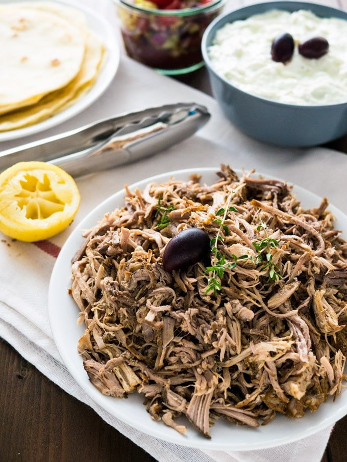 The best Slow Cooker Pulled Pork Gyros - made with my Greek Gyros spice mixture! This easy recipe is perfect for Greek-Style Tacos or simple Sandwichs with coleslaw.