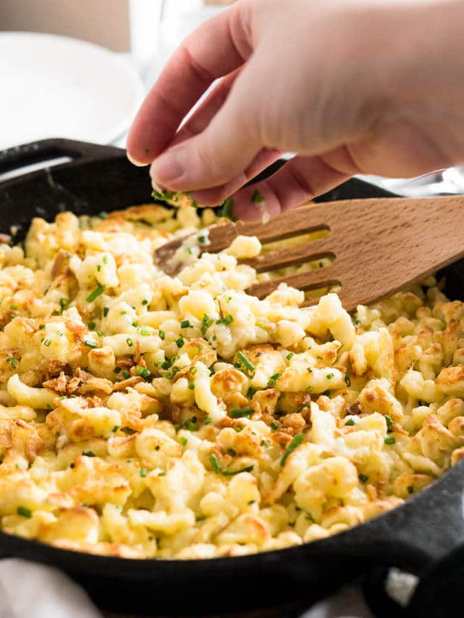 Cheese Spaetzle (Käsespätzle) is the German version of Mac and Cheese! Made with german egg noodles and Emmental cheese. This Bavarian dish is special enough for an Oktoberfest party but so easy that you can make it every day!