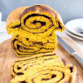 Nutella Swirl Pumpkin Bread is perfect for a holiday brunch! Swirls of Nutella and a pumpkin enriched dough make this loaf a delicious and decadent treat!