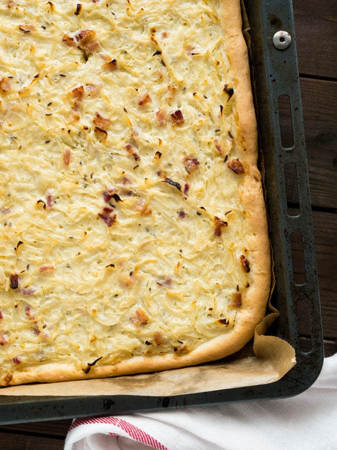 This Onion Tart is made with bacon and a really big amount of onions! It tastes best lukewarm with a glass of wine or some freshly squeezed grape juice. A perfect fall appetizer or snack!