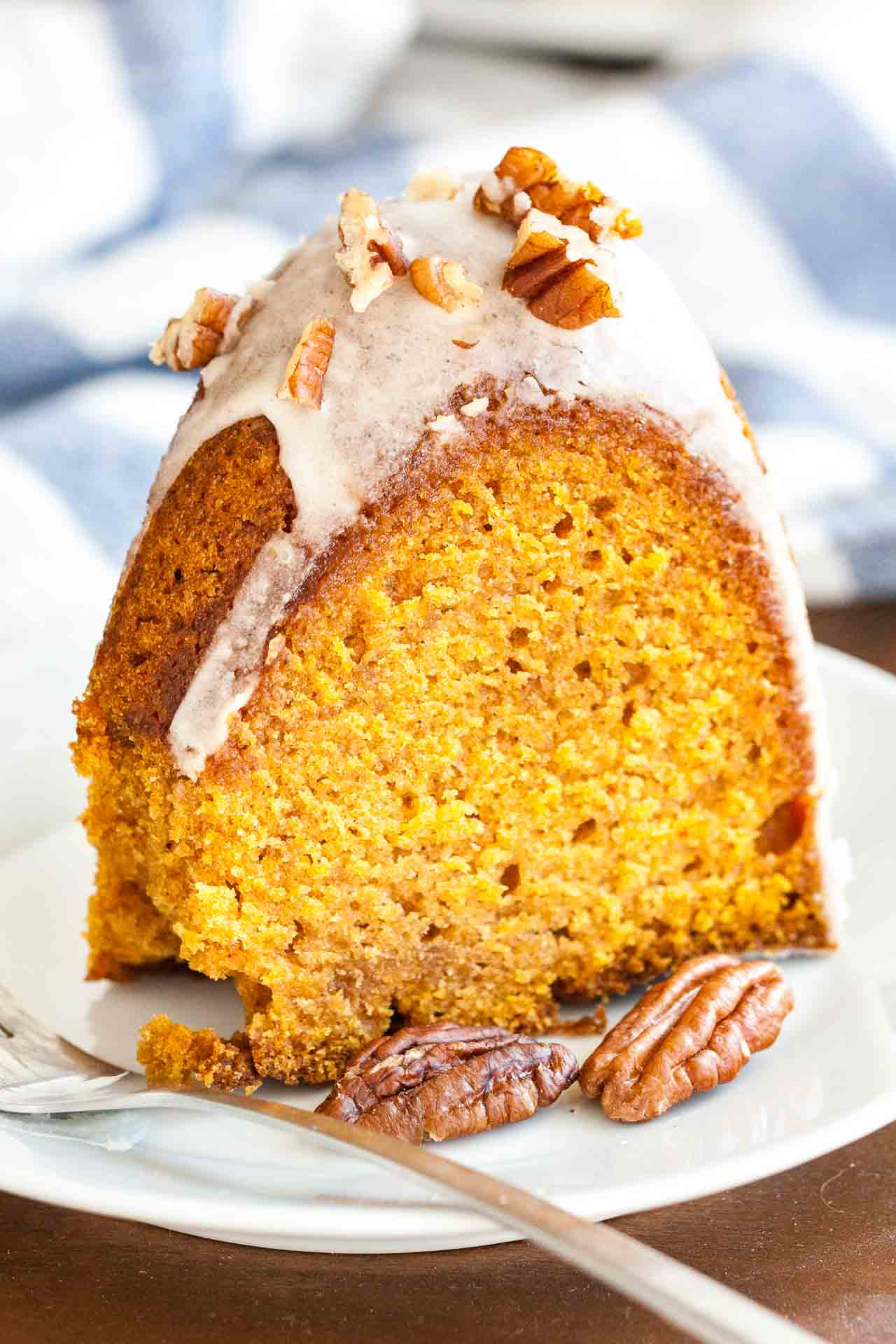 "This Pumpkin Bundt Cake is super moist and topped with a maple glaze and toasted pecans! A perfect dessert for the holidays that ""wow's"" and is easy enough to make even if you aren't totally kitchen confident."