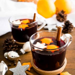 This spiced grape holiday punch is the perfect beverage to serve at your winter celebrations! Hot mulled grape juice is flavored with Christmas spices making it the perfect non-alcoholic beverage for the holidays!