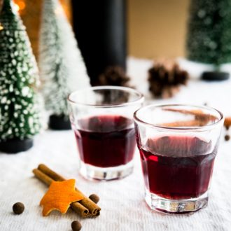 This easy mulled wine liqueur makes a perfect Christmas gift! Dark rum and red wine are infused with mulling spices, making this homemade drink as festive as the holiday season gets.