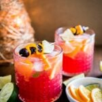 This Orange Cranberry Moscow Mule is the perfect holiday drink! A festive spin on a traditional cocktail made with cranberry juice, fresh oranges, and lime.