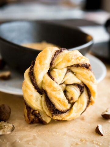 These Twisted Nutella Danish pastries are buttery, flaky, and filled with Nutella! Easy enough to whip up on a weeknight, yet special enough for a party.