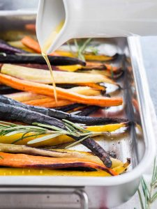 These Brown Butter Maple Glazed Roasted Rainbow Carrots are the easiest and most delicious side dish! Oven roasted carrots with a simple 3-minute glaze. So easy to make yet elegant enough for special occasions like Easter or Thanksgiving dinner!