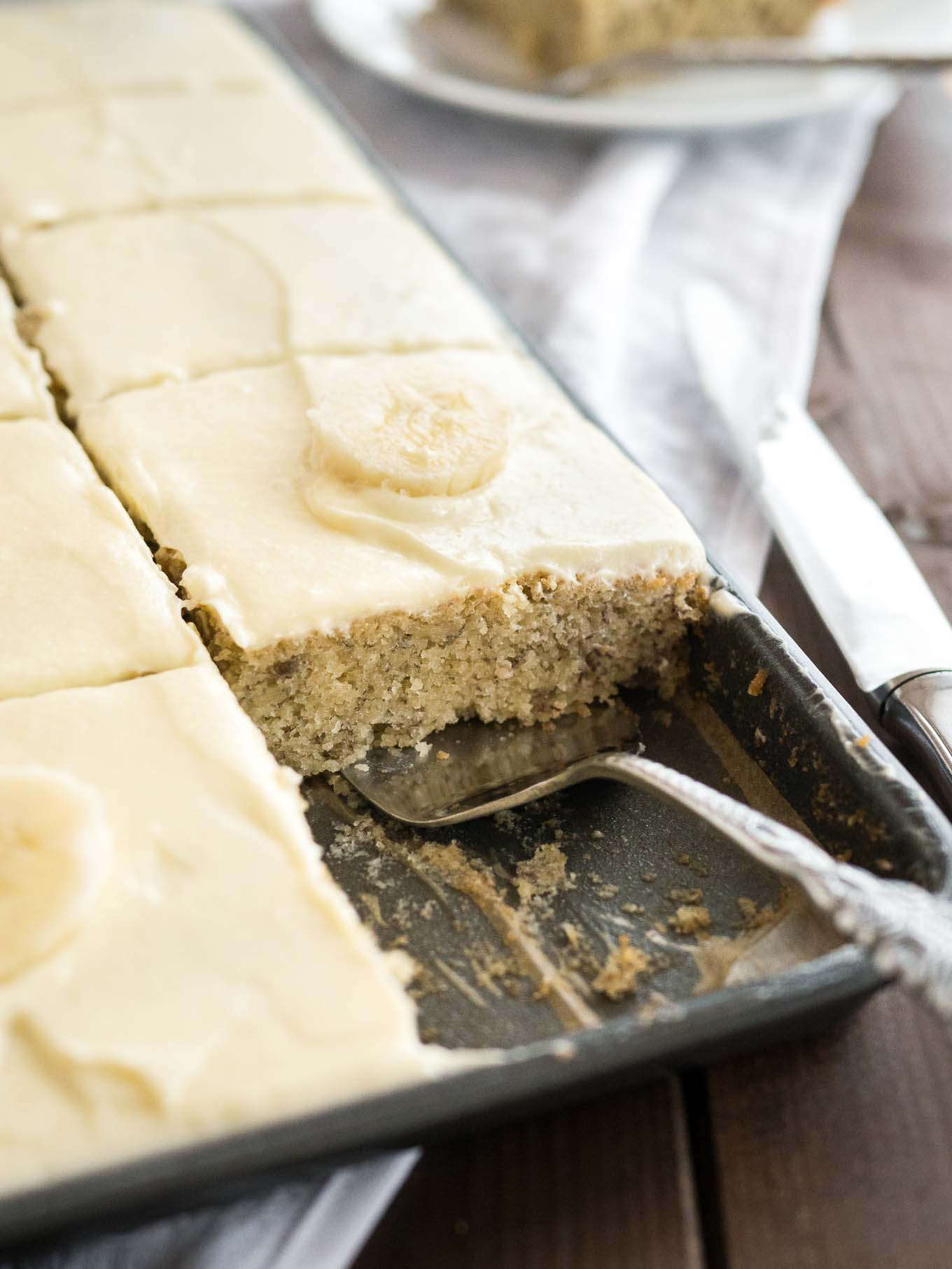 Easy Banana Cake - this fluffy and moist sheet cake has a mascarpone frosting on top and is ready in under 30 mins! A perfect cake to use overripe bananas.