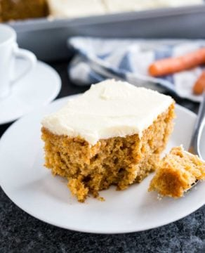 This easy Carrot Cake is deliciously moist and topped with a smooth cream cheese frosting! A nut-free sheet cake that is ready in 30 minutes and super simple to throw together.