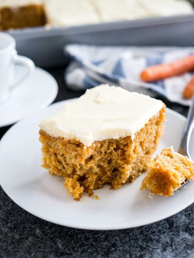 Easy Carrot Cake is deliciously moist and topped with a smooth cream cheese frosting! A nut-free sheet cake that is ready in 30 minutes and super simple to throw together.