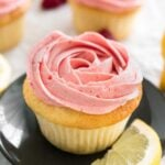Raspberry Lemon Curd Cupcakes - Flavorful and moist lemon curd cupcakes topped with a silky and smooth raspberry meringue buttercream! You are going to LOVE these beautiful lemon raspberry cupcakes.
