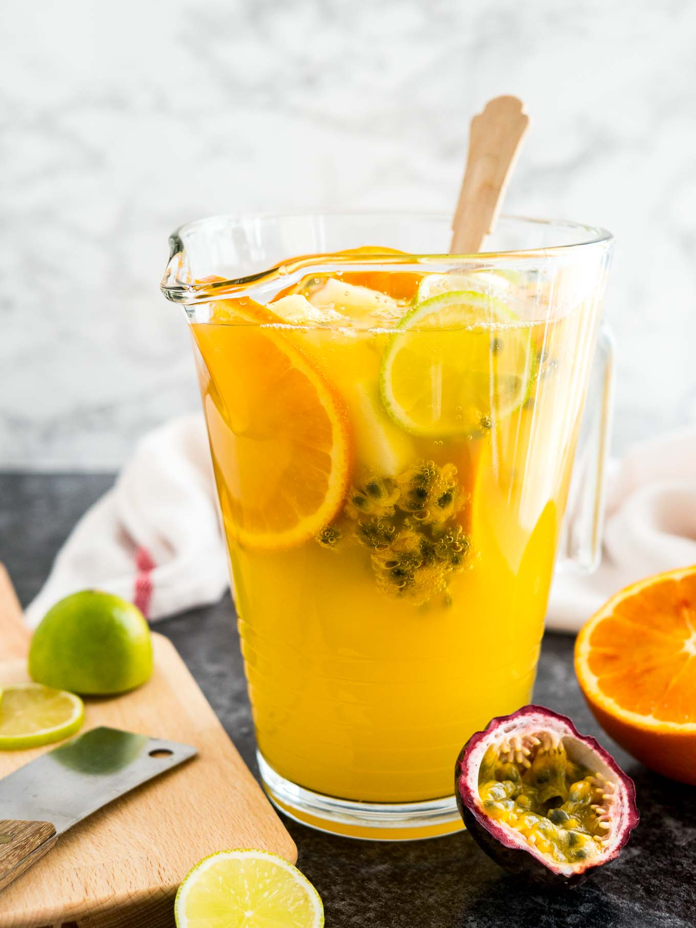 Tropical white wine sangria recipe with passion fruit and for Champagne drinks with fruit
