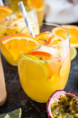 This Tropical White Wine Sangria is the perfect drink for any occasion! Fruity, bubbly and so delicious, this easy, crowd-pleasing recipe is super refreshing and comes together in minutes.