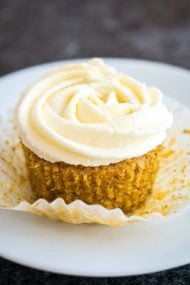 The best Carrot Cake Cupcakes with a not-too-sweet cream cheese frosting on top! These carrot cupcakes are perfectly moist, lightly spiced and so flavorful. A perfect dessert for Easter!