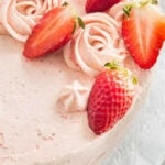 This homemade Strawberry Cake Recipe is bursting with fresh strawberry flavor and made completely from scratch! Layers of soft and fluffy vanilla cake filledwith a strawberry buttercream and a layer of fresh strawberry filling.A perfect cake for spring and summer! #strawberrycake #cakefromscratch #strawberry #strawberries #layercake