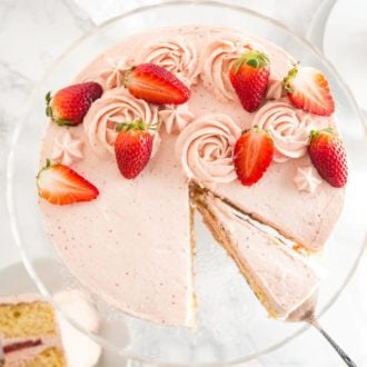 This homemade Strawberry Cake Recipe is bursting with fresh strawberry flavor and made completely from scratch!