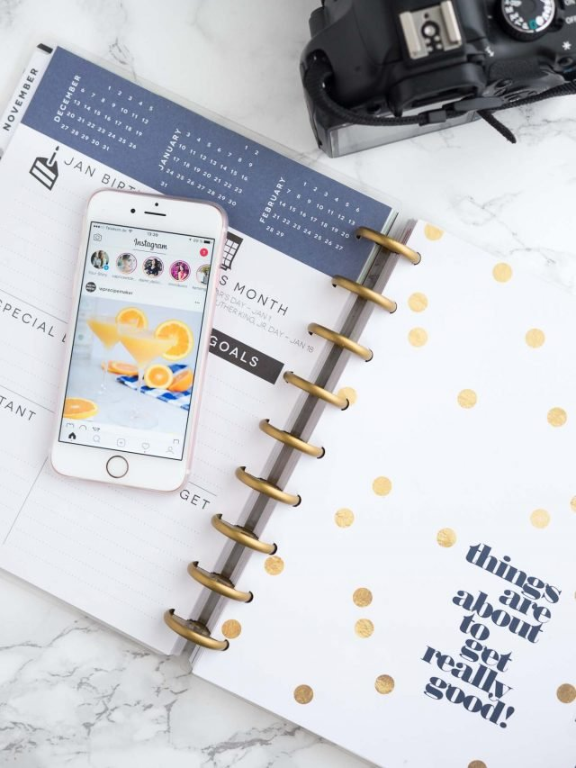 a picture of a planner, a phone, and a camera