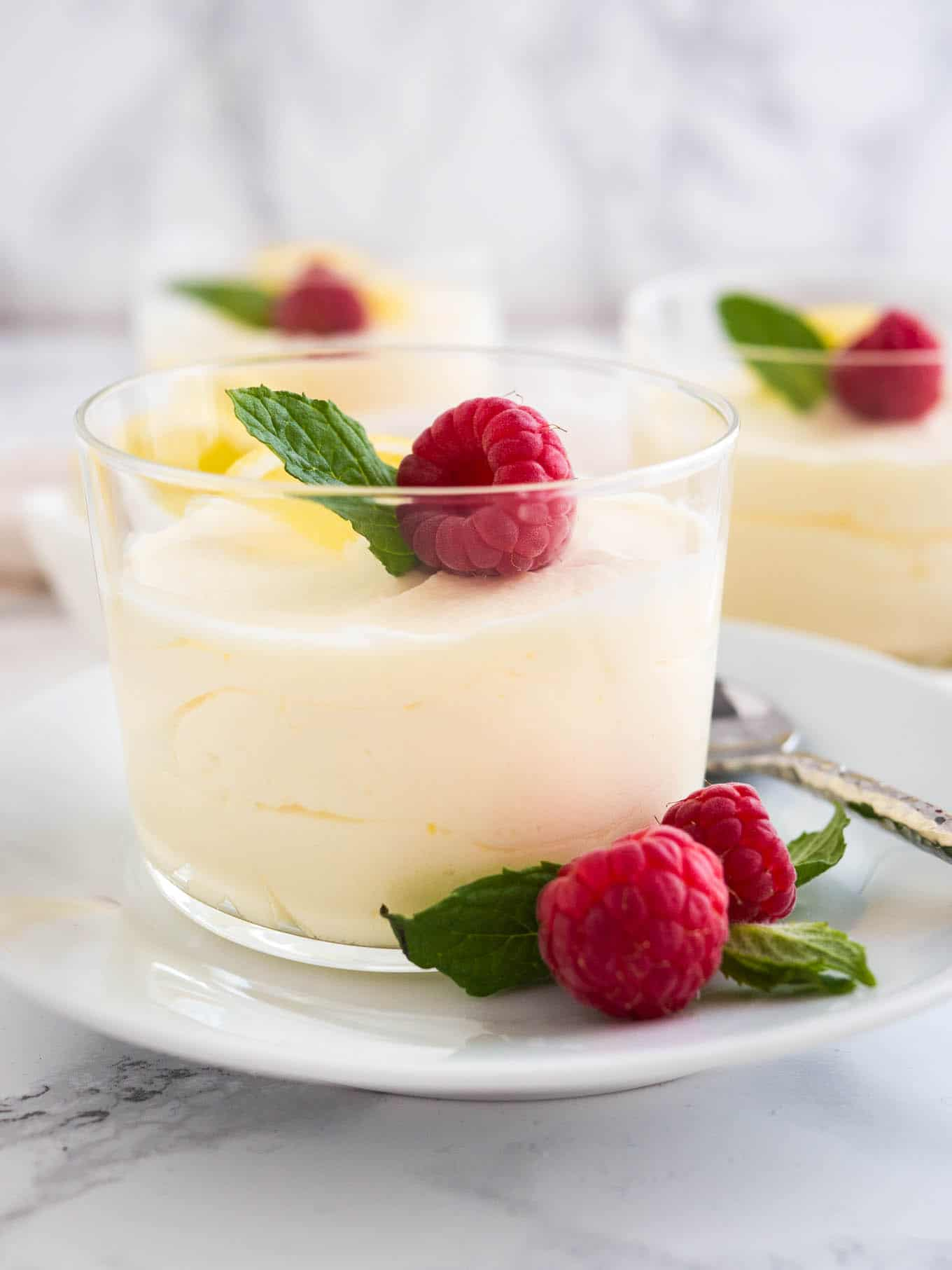 This easy Lemon Curd Mousse is served in individual glasses, perfect for dinner parties!