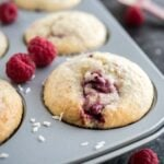 Coconut Raspberry Muffins are super moist, bursting with coconut flavor, and are studded with juicy raspberries. These easy muffins are perfect for breakfast, brunch, or dessert!