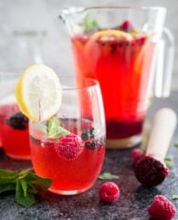 This Homemade Raspberry Lemonade is sweet, tangy and so refreshing! An easy simple syrup made from fresh raspberries is the base for this fruity sparkling drink that is perfect for summer entertaining.