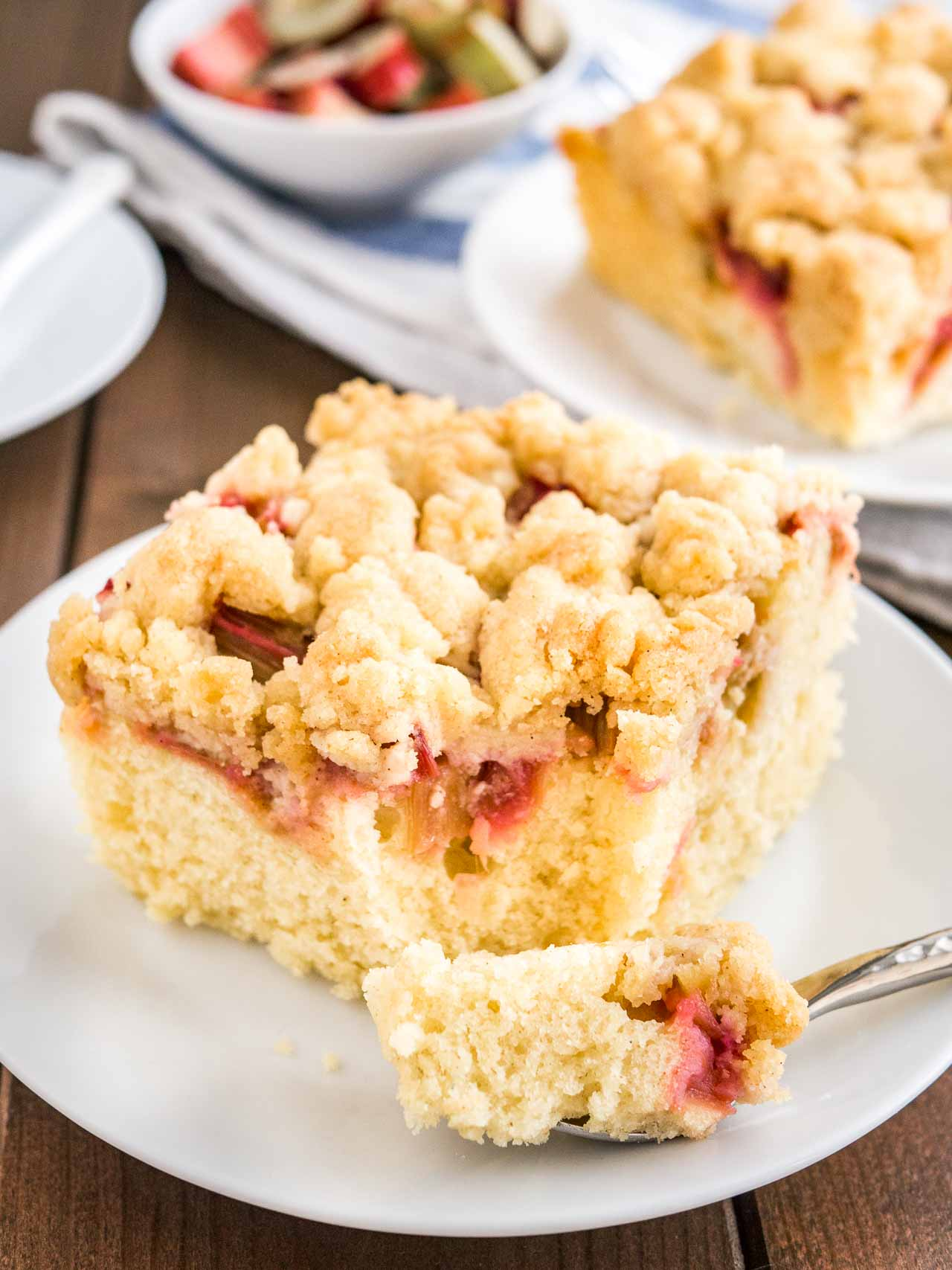 Rhubarb Coffee Cake is topped with cookie-like streusel and every bite is studded with juicy rhubarb! An easy-to-make sheet cake that's not too sweet and not too tangy, just delicious.