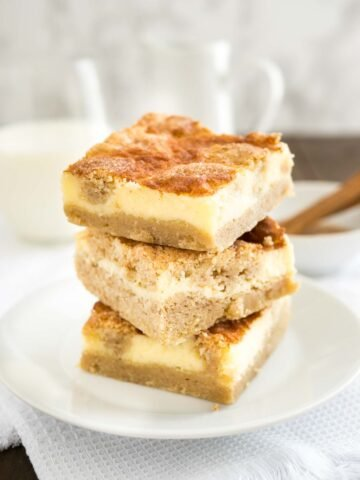 Snickerdoodle Cheesecake Bars are the best of both worlds with a creamy cheesecake top and a soft cinnamon-sugary snickerdoodle cookie bottom.