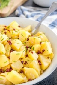 Authentic German Potato Salad is made with vinegar, broth, and oil and can be served warm or cold. A perfect side dish for any occasion from summer BBQs to family dinners!