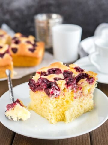 Cherry Cake with sour cherries and vanilla is a simple snack cake that tastes delicious and is so easy to make in less than 10 minutes. Perfect for surprise guests and evening sweet tooth cravings!