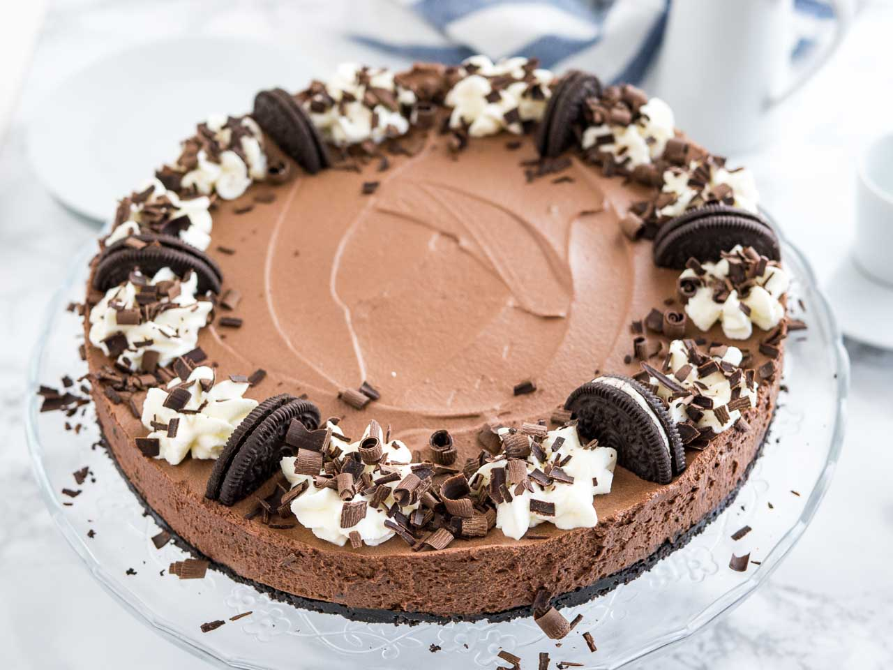 Chocolate Mousse Cake is every chocolate lovers dream! An Oreo crust filled with a decadent dark chocolate mousse topped with more Oreos, whipped cream, and chocolate. This no-bake dessert is perfect for special occasions but so easy to make from scratch!