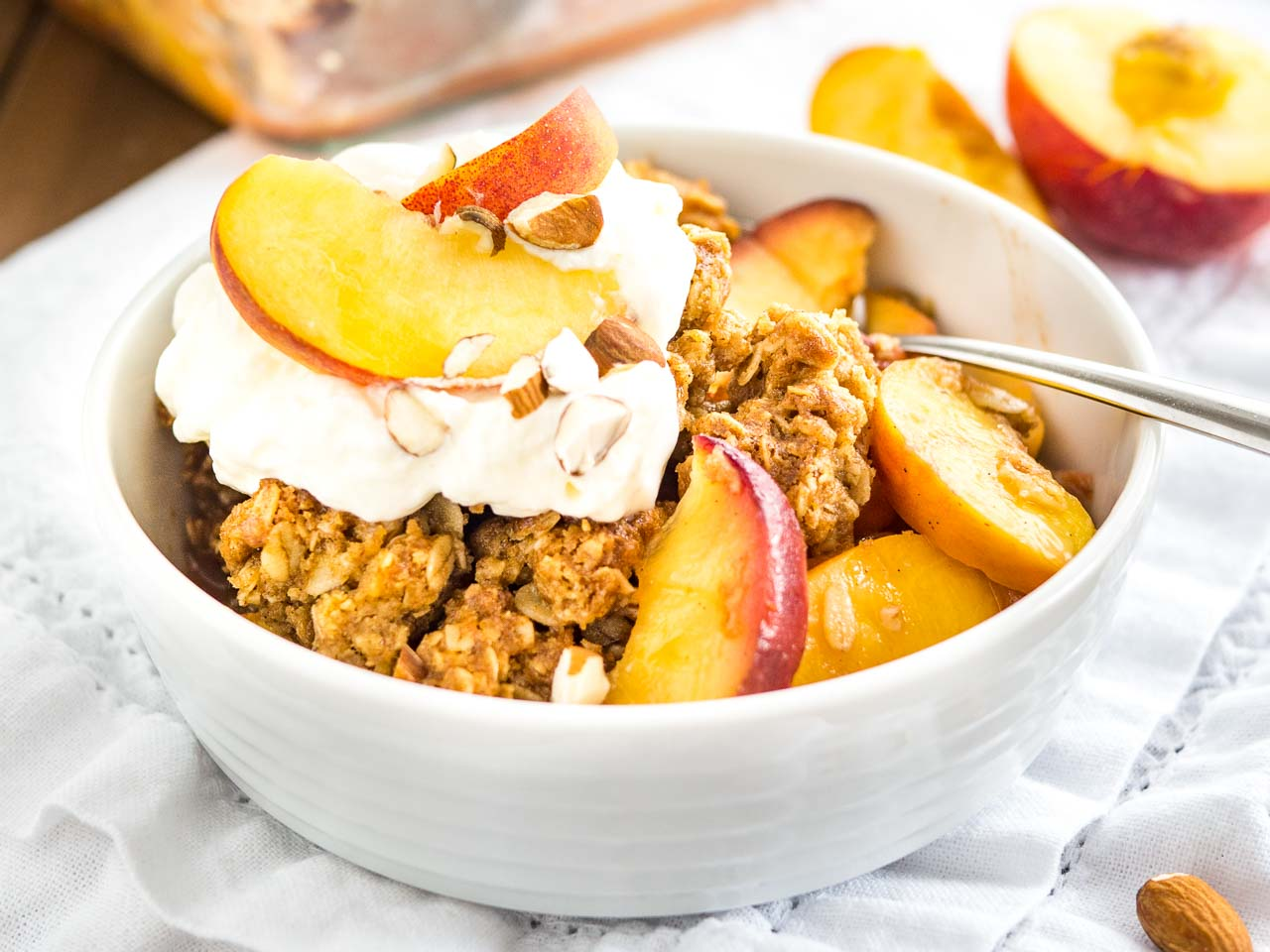 Peach Crisp is made with fresh peaches and topped with a crunchy oatmeal brown sugar streusel! This easy summer dessert is the ultimate comfort food.