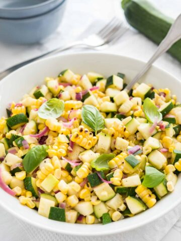 Roasted Corn Zucchini Salad is an easy but so flavorful vegetable side dish made with fresh corn, zucchini, and onions. A delicious summer salad that will dress up every meal.